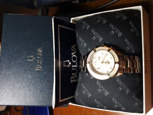 Ladies Bulova diamond accent watch with mother of pearl dial