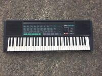 Yamaha keyboard used with stand
