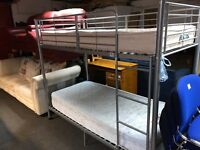 Silver bunk beds with mattresses