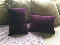 Two small purple cushions
