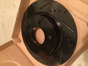 Max Advanced drilled and slotted rear rotors and break pads