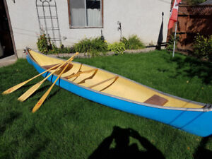 16 foot Fibreglas LAKE canoe;  excellent condition, three paddle