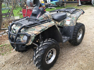 2007 can-am outlander 800.   Trade for side by side