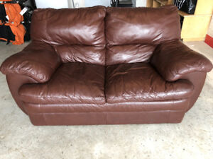 Leather sofas and coffee table and end table
