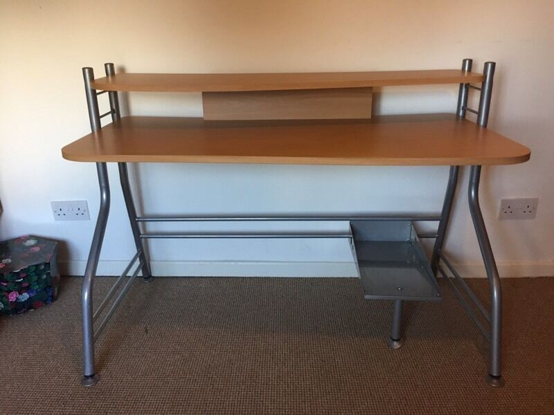 Computer deskin Childwall, MerseysideGumtree - Computer desk with curved top and removable computer shelf. Measures 120 cm wide and 67 cm deep at its widest point. Writing part of desk is 73 cm high. Comes apart for transport easy assembly
