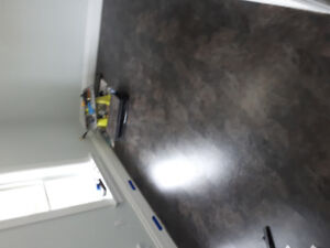 Flooring installations and stair refinishing.