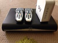 Sky hd box and two remotes and hub