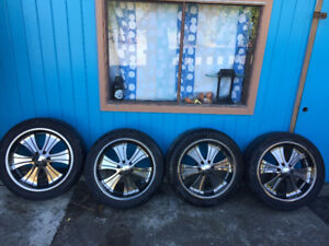 Chevy rims and tires 22 inch Boss Black Crome.$800.