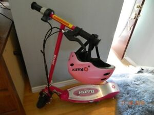 Electric E100 Razor scooter with new battery and matching helmet