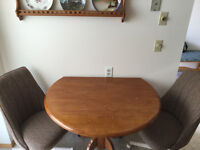 Table with cloth roller swivel chairs