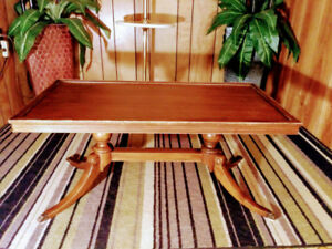 Solid mahogony wood coffee table with brass claw legs