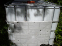 plastic tank with steel cage around it