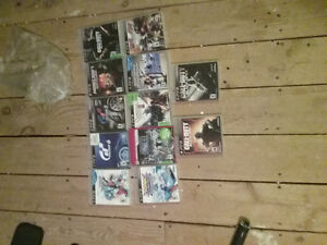 Playstation 3 with Move and 12 Games with Controllers