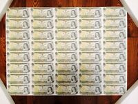 Two Uncut Sheets of one dollar bills from The Bank of Canada.