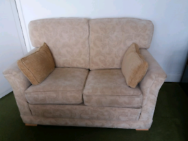 Two seater cream fabric sofa settee