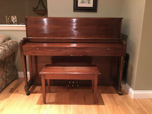 Baldwin upright piano on casters