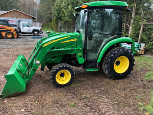 John Deere Compact Tractor With Accessories