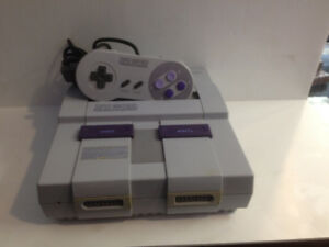 Super Nintendo Entertainment System with one controller