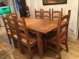 Extending solid pine wood dining table & 8 chairs