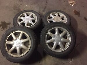 VW wheels and near new winter claw extreme grip tires