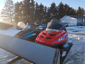 Two sleds and trailer