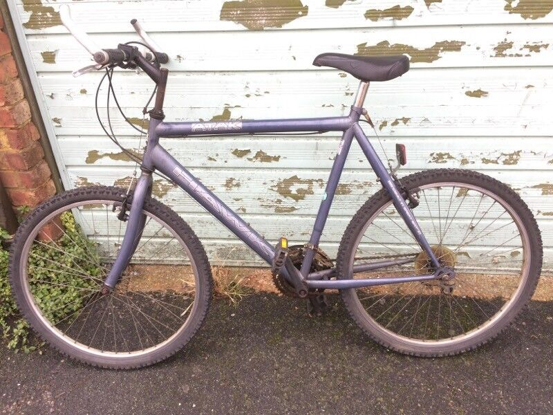 Mens bicycles, one 'mountain' other 'town'