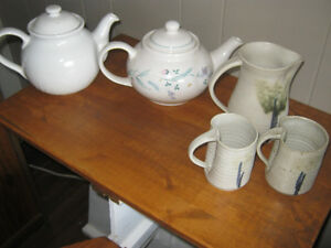 Two teapots and homemade pottery water jug