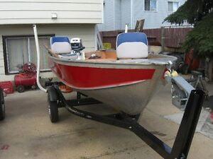 VERY NICE FISHING PACKAGE---12 FT BOAT---MOTOR---TRAILER