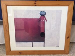 Dog with Apple on head in wooden frame
