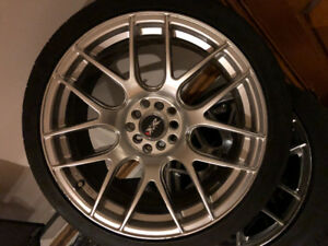 Selling my xxr rims with brand new rubbers