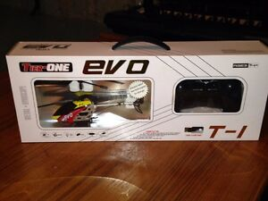 Brand new. Never opened. Evo T1 Toy Helicopter with remote London Ontario image 4