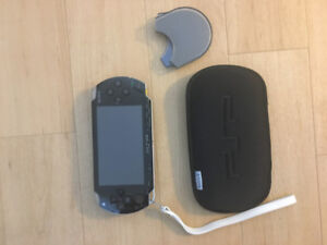 PlayStation Portable (PSP) - includes games and movies