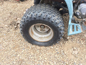 two  22-10-10 or two 22-11-10 quad tiresor 12' rims