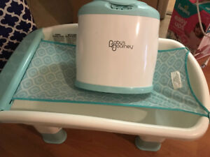 Baby's Journey Towel Warmer And bath tub.