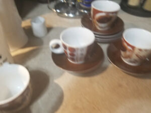6 Espresso cups with saucers. $10 or best offer