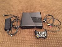Xbox 360 S with cables and controller