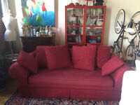 Deep red couch with pillows! Comfortable enough to sleep in!