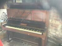An upright Waddington Piano
