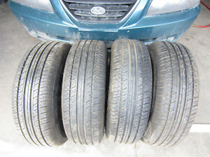 4 Ultrex AS4 Touring tires 205/70/14 on steel rims 5x108