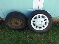 Studded Goodyear Nordic winter tires on rims for sale