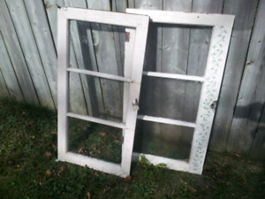 Two vintage storm windows for sale