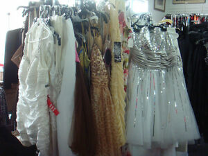 Bridal salon.Wedding and Prom dresses, Men tuxedo.