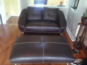 leather love seat and matching ottom