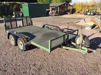 Twin axle flatbed car trailer