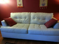 off white two leather couches