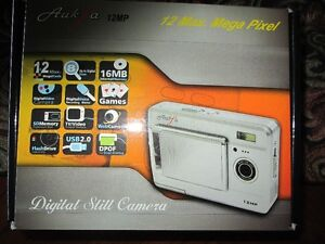 DIGITAL CAMERA WITH ACCESSORIES & MORE