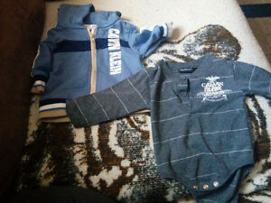 Baby boy clothes including a Calvin Klein onesie and zip hoodie