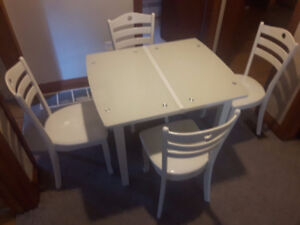 Gorgeous Kitchen table with extension.4 chairs. $259 obo