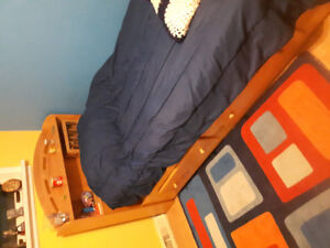 Twin bed with shelf headboard and 2 bottom drawers
