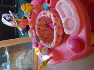 Pink and lime green  adjustable exersaucer